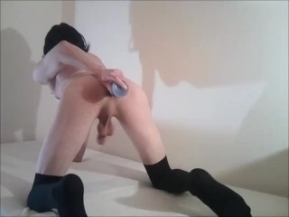 t-girl is playing with a dildo