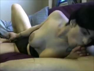 Brunette lady boy with huge titties blowing a dude